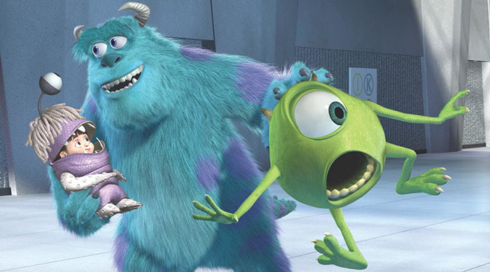 Mike, Sully and Boo running from Randal in Disney Pixar's Monsters, Inc.