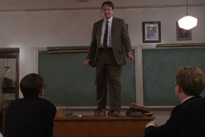 Professor Keating standing on his desk in Dead Poets Society