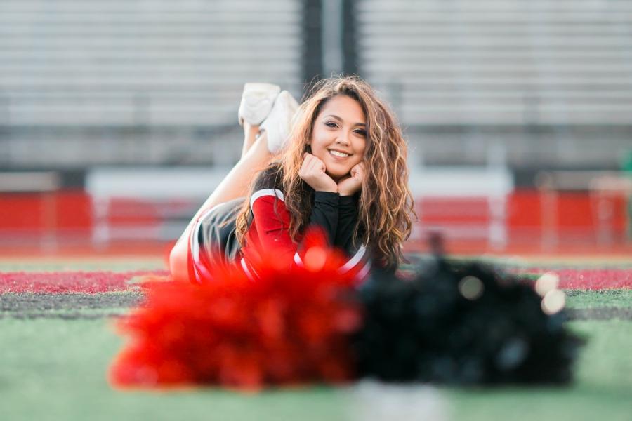 Cheerleader taking senior portrait