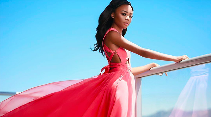 Skai Jackson photographed in a flowing pink dress