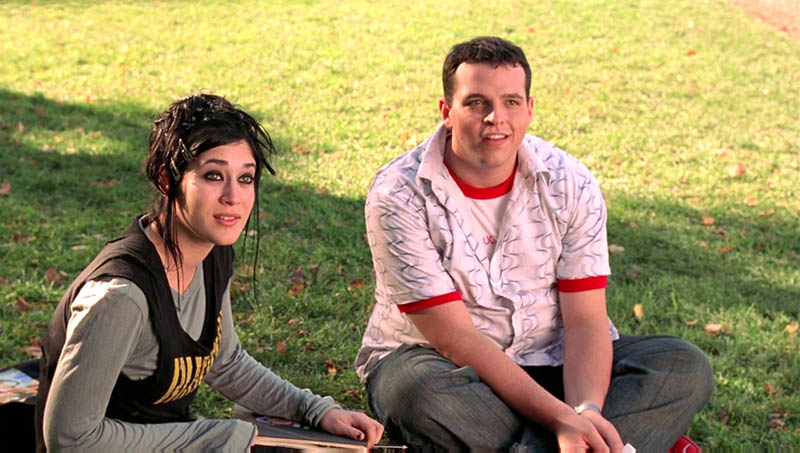 Damian and Janis sitting out on the school's field in Mean Girls