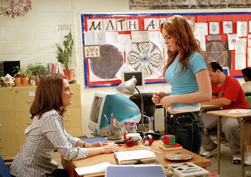 Cady turning in her AP Calculus exam to Miss Norbury in Mean Girls