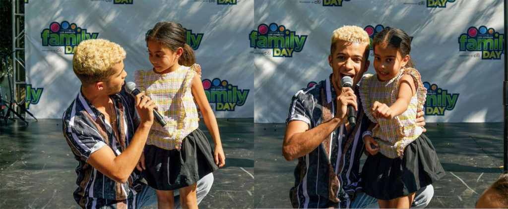 Jordan Fisher on stage with fan