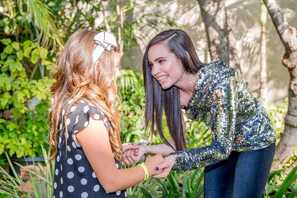 Sofia Carson talks to fan at TJ Martell family day
