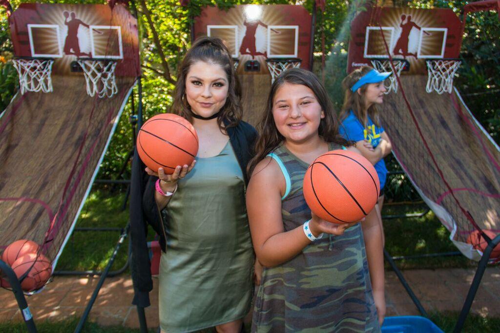 Hannah Zeile and Mackenzie Hancsicsak play basketball