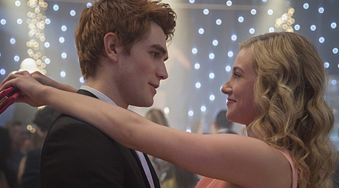 "Riverdale -- ""Pilot"" -- Image Number: RVD101c_0234.jpg -- Pictured (L-R): KJ Apa as Archie and Lili Reinhart as Betty -- Photo: Diyah Pera/The CW -- © 2016 The CW Network. All Rights Reserved."