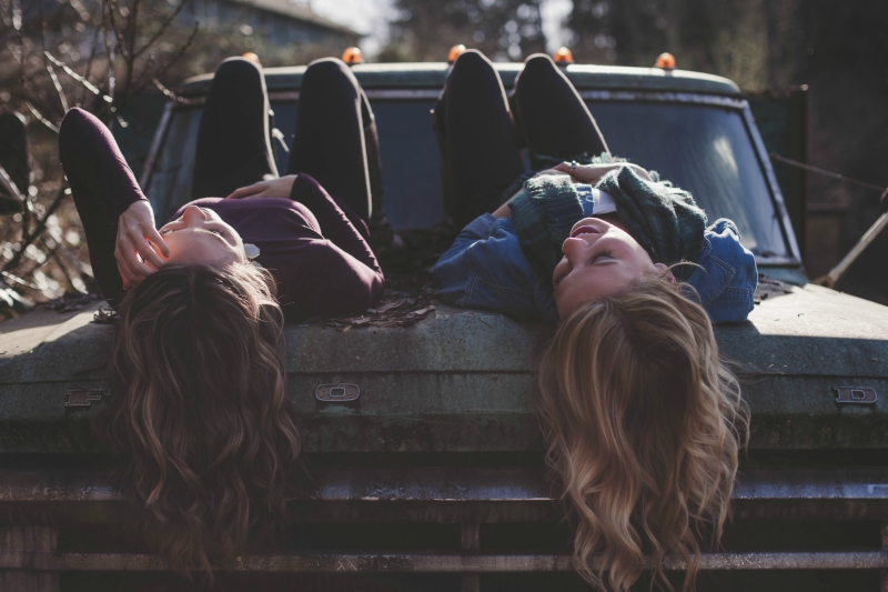 Friends Laying on a Truck