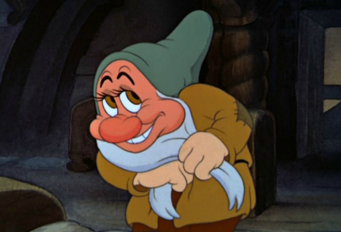 Bashful showcasing his shyness after Snow White kissed him on the head in Snow White and the Seven Dwarfs