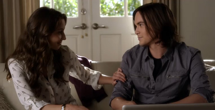 Caleb helping Spencer with something on Pretty Little Liars