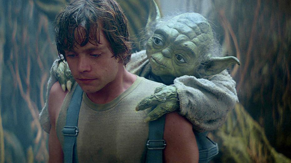 Yoda riding on Luke Skywalker's back