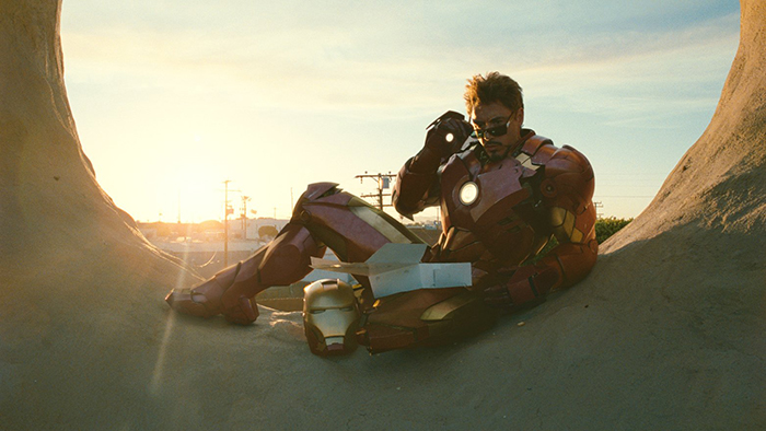 Tony Stark eating donuts inside of the Randy's Donuts giant donut
