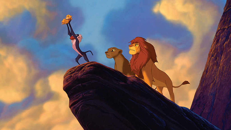 Simba being held up by Rafiki on Pride Rock in Disney's The Lion King