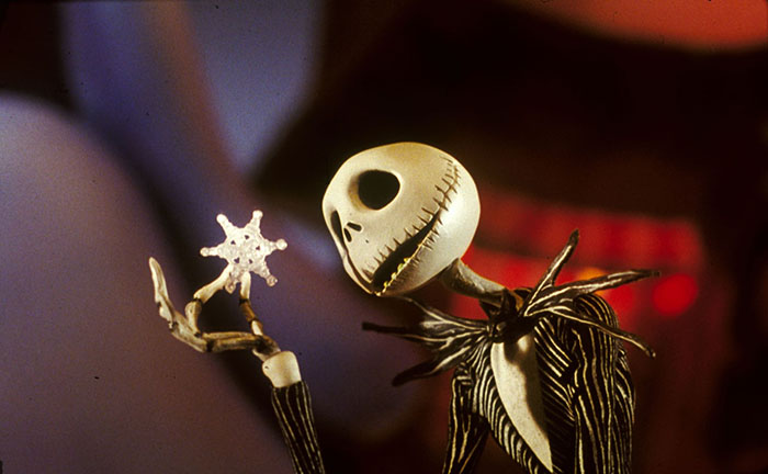 jack skellington looking at a snowflake in tim burtons the nightmare before christmas - Christmas Jack Skellington
