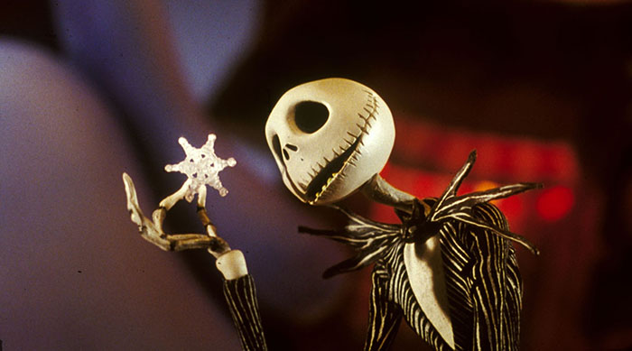 Jack Skellington looking at a snowflake in Tim Burton's The Nightmare Before Christmas