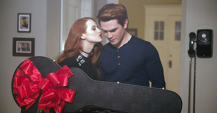 Cheryl kissing Archie after giving him a guitar on Riverdale