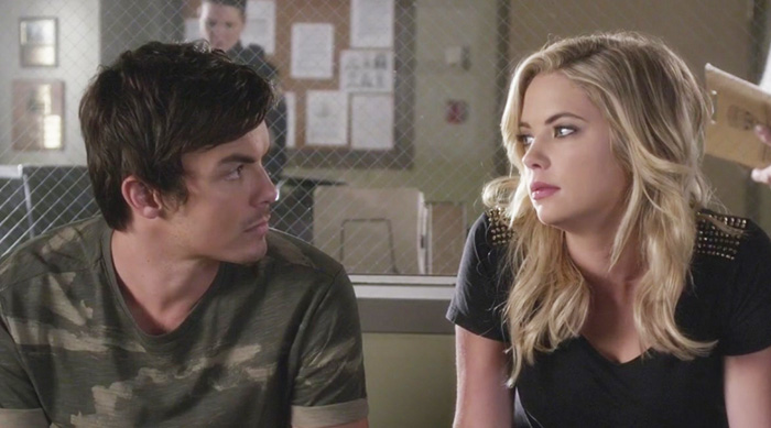Caleb and Hanna talking to each other at the sheriff's station on an episode of Pretty Little Liars