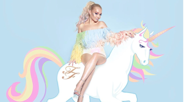 Raelynn Sitting on a Unicorn