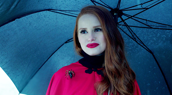 Cheryl Blossom holding an umbrella while walking in the rain on Riverdale