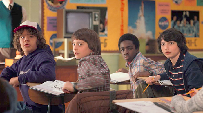 Stranger Things boys in class: Dustin, Will, Lucas and Mike