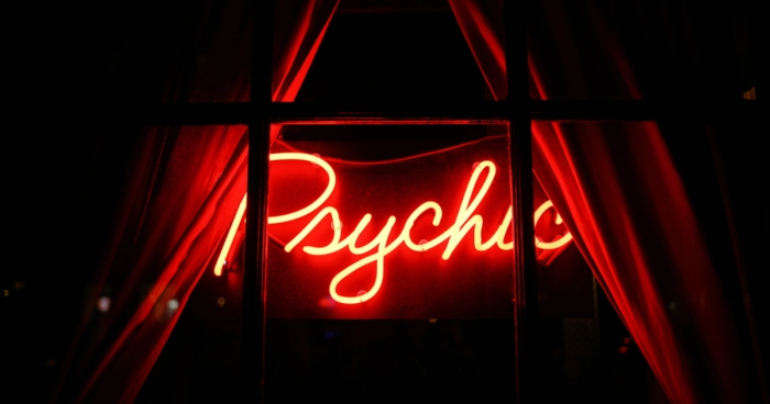 Psychic sign on window