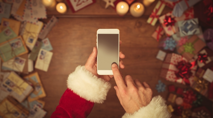 Santa hands with phone