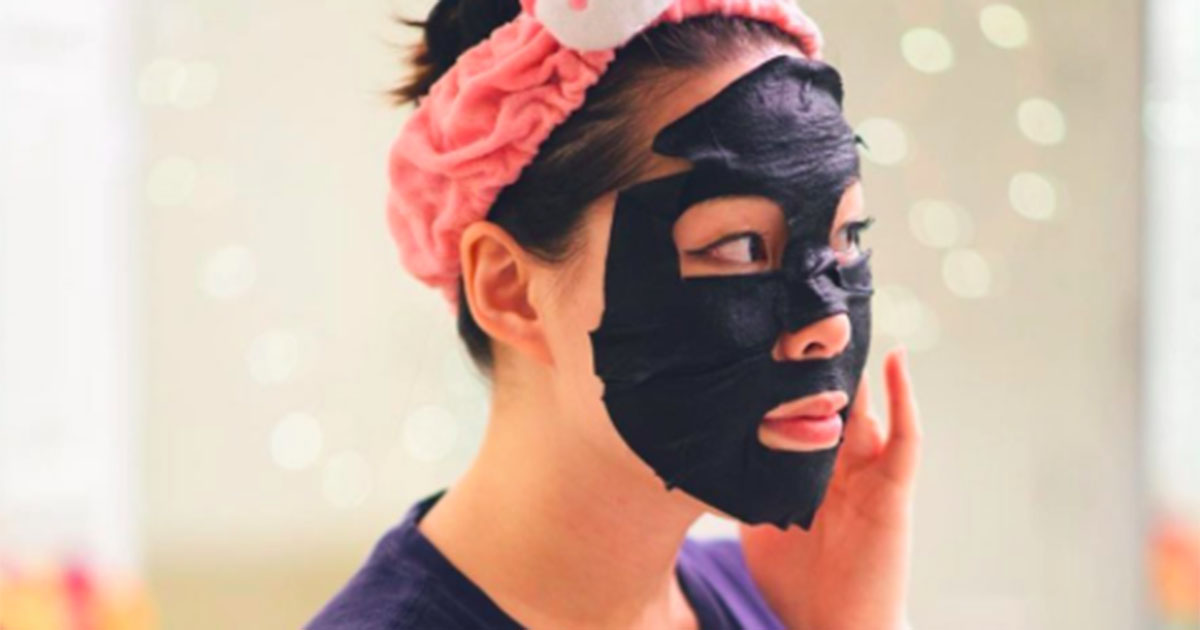 Girl wearing a Yes To Charcoal sheet mask