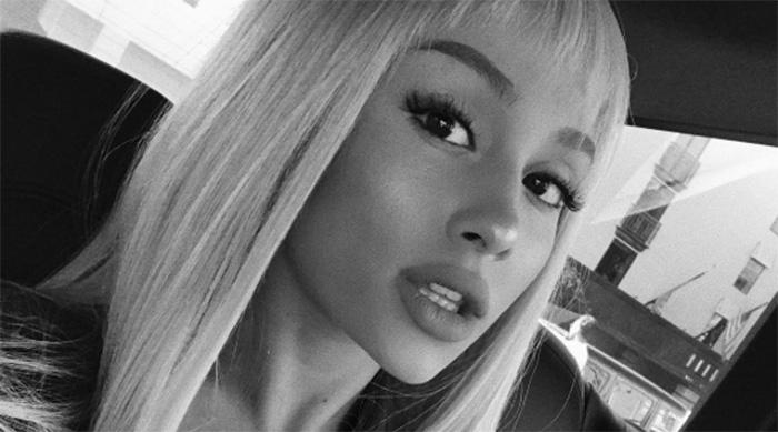 Ariana Grande wearing a blonde wig