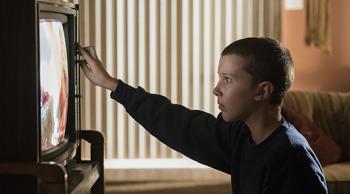 Stranger Things: Eleven watches TV