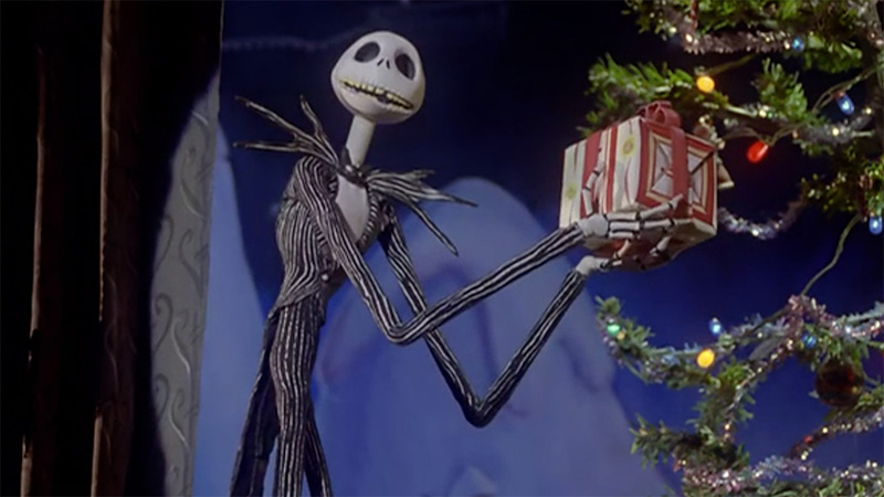 jack skellington holding a present in the nightmare before christmas