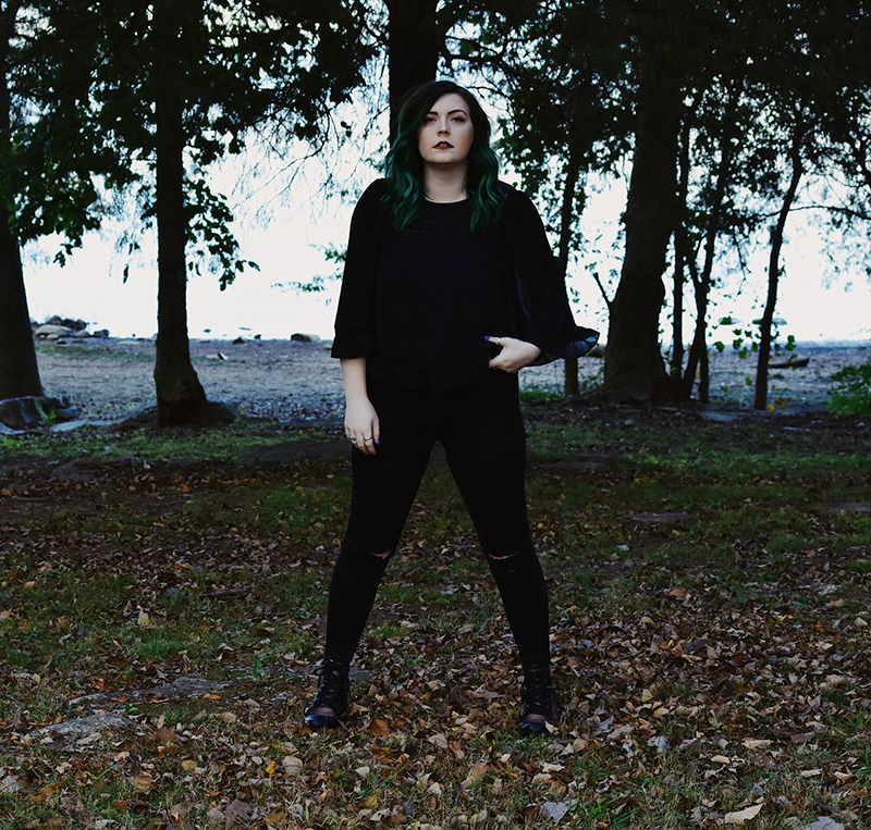 Singer-songwriter LIEZA standing tall in a forrest