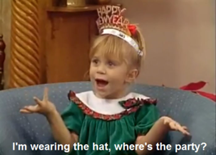 Michelle Tanner wearing a 'Happy New Year' hat on Full House