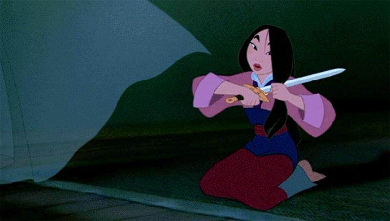 Mulan cutting her hair in the Disney cartoon