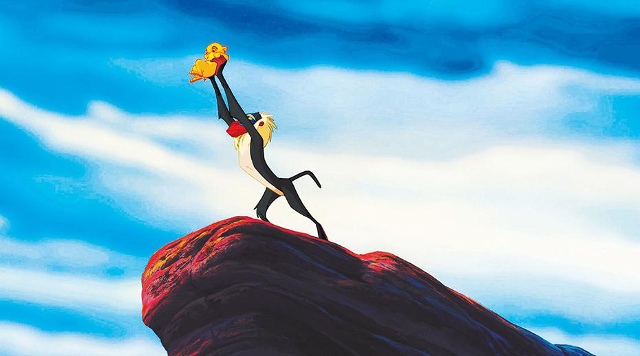 Rafiki lifting Simba in The Lion King