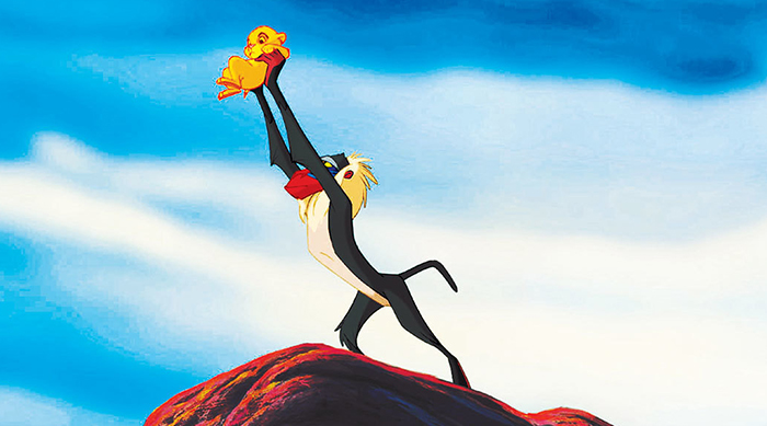 Rafiki lifting Simba in The Lion King