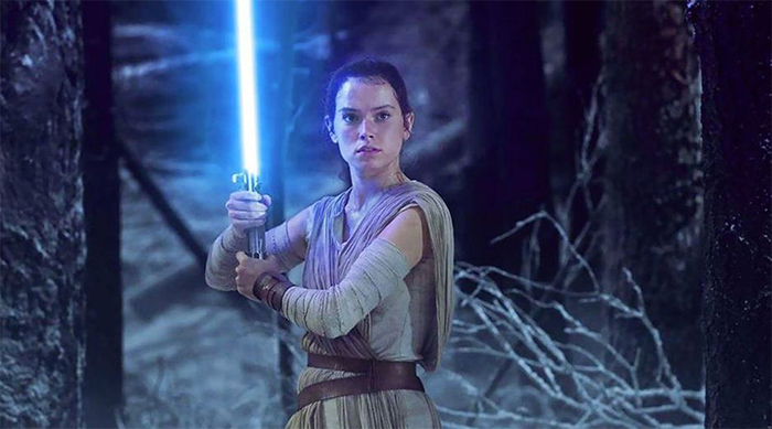 Rey in The Force Awakens with blue lightsaber