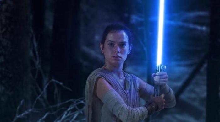 Rey Holding a Blue Lightsaber