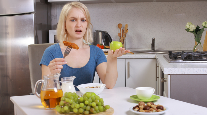 girl hates food at dining table