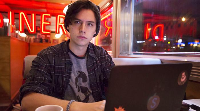 Jughead Jones on his laptop at Pop's on Riverdale