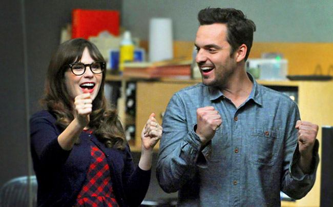 Jess and Nick celebrating on New Girl