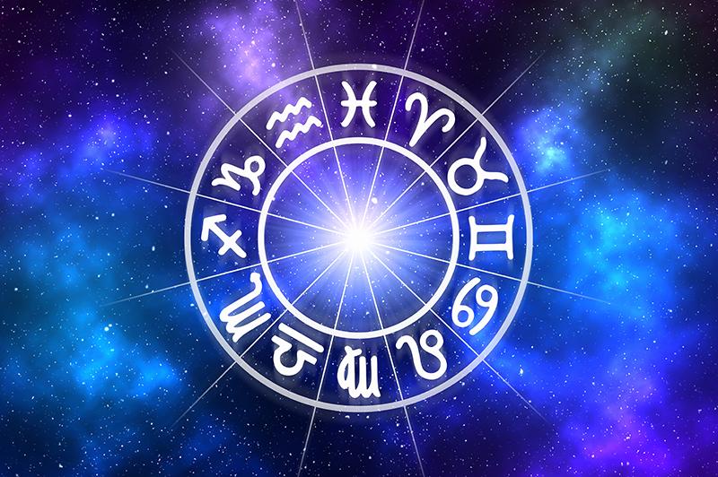 Zodiac signs in a wheel on a galaxy background