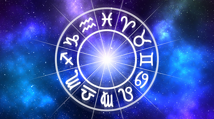 Zodiac signs in a wheel on a galaxy background
