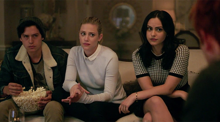 Jughead, Betty and Veronica all glaring at Archie on an episode of Riverdale