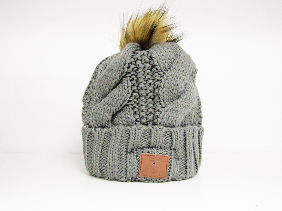 dcbc34e2aa47d Grey cable knit tenergy Bluetooth beanie with brown pom-pom