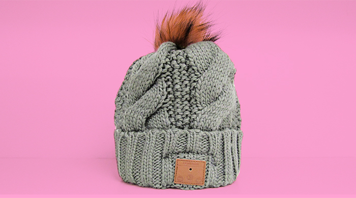 Grey cable knit tenergy Bluetooth beanie with brown pom-pom