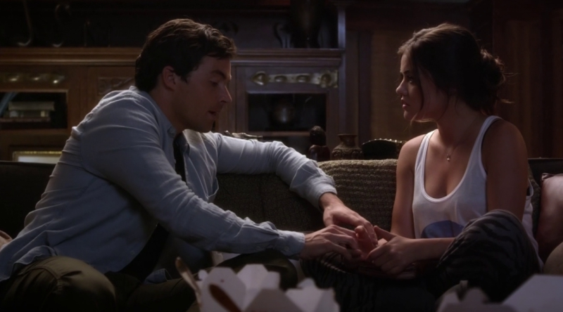 Aria and Ezra Talking on the Couch