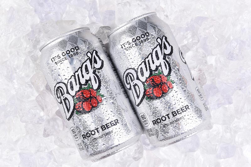 Two cans of Barq's Root Beer on ice
