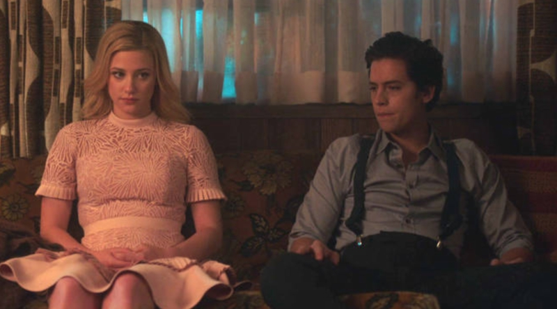 Betty and Jughead Sitting on a Couch