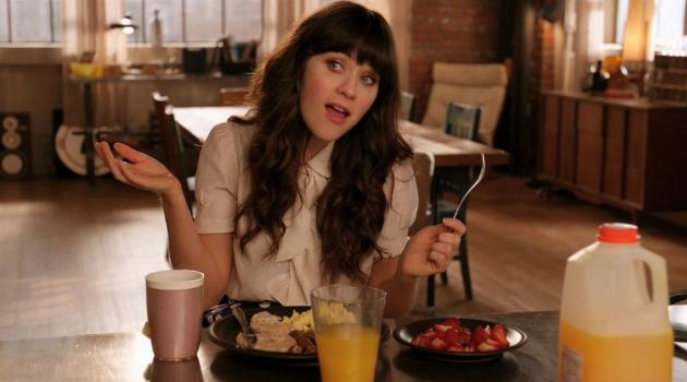 Jess eating breakfast alone on New Girl
