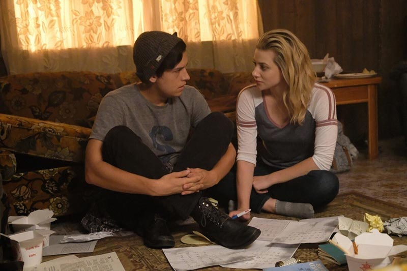 Betty and Jughead looking at Black Hood evidence on Riverdale