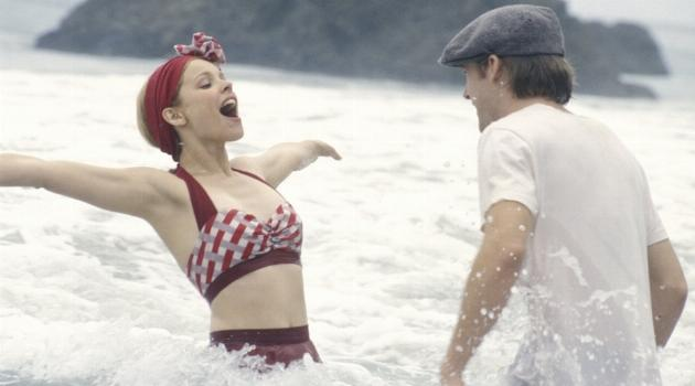 Noah and Ally playing in the ocean in The Notebook